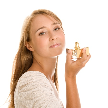 Young woman testing perfume photo