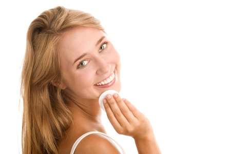 removing make up: Young woman using cleansing pad Stock Photo