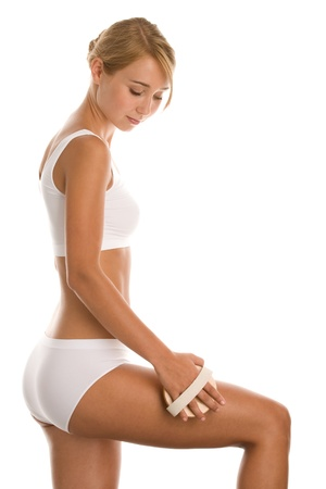 Young woman in underwear with massage brush