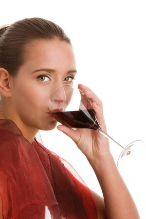 Young woman drinking red wine photo