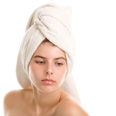 wrapped in a towel: Young woman with hair wrapped in towel