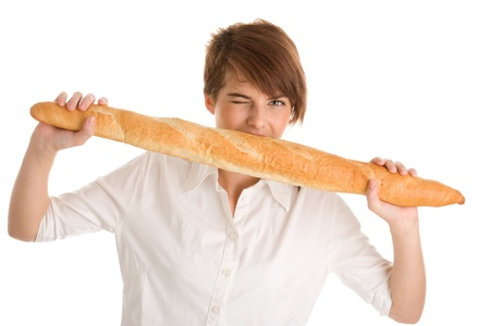 Young woman eating baguette