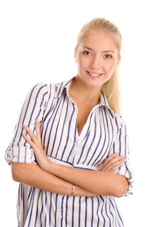 Portrait of young blonde woman with arms crossed photo