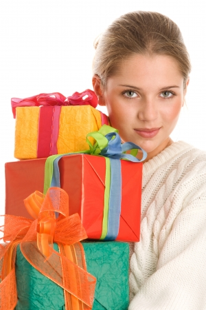 Young woman holding stack of gifts photo