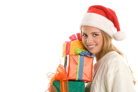 Young woman with Santa cap with pile of gifts photo