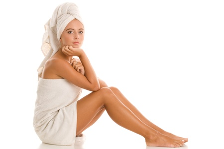 Woman in bath towel relaxing in spa photo