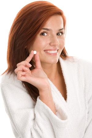Woman holding pill