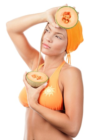 Woman in bikini with cantaloupe photo