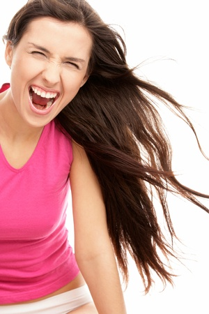 Screaming woman with flying hair photo