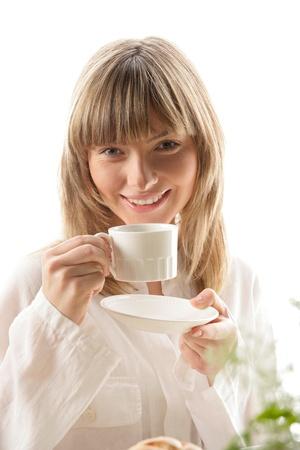 Woman drinking coffee Stock Photo - 16732590