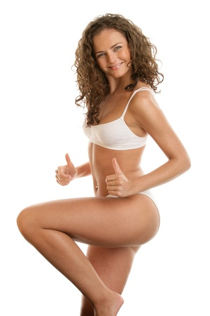 Young woman in lingerie giving thumbs up photo