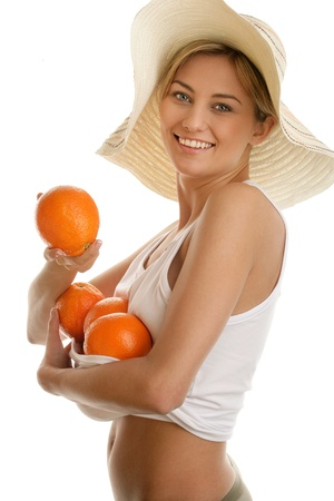 Farm woman holding fresh oranges photo