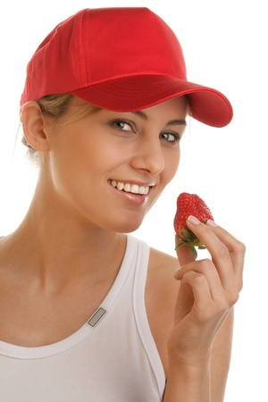 Woman eating strawberry photo