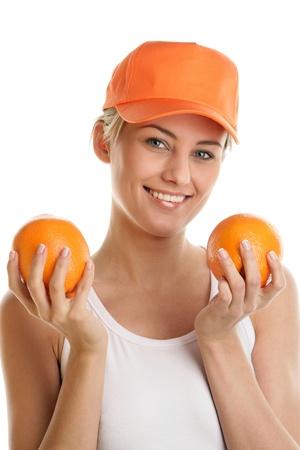 Woman holding fresh oranges