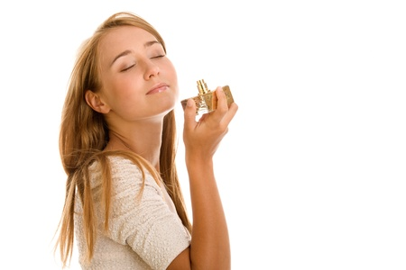 Young woman tasting perfume photo