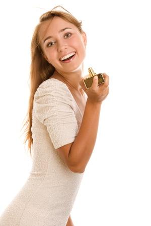smirking: Woman holding perfume bottle Stock Photo