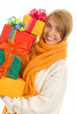 Woman holding stack of gifts Standard-Bild