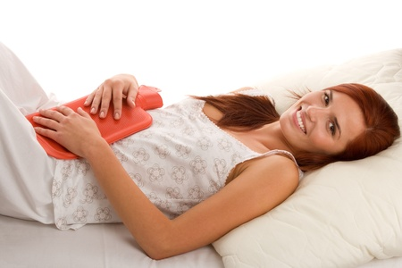 Woman with hot water bottle photo