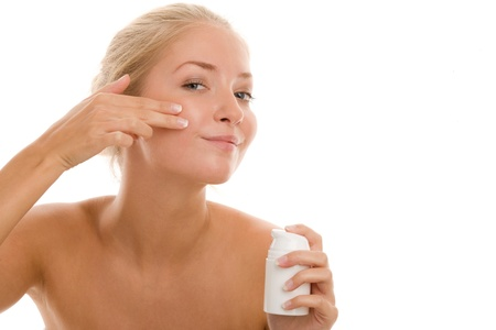 naked youth: Woman applying beauty cream