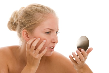 naked youth: Woman finding acne Stock Photo
