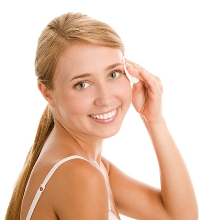 removing make up: Young woman removing makeup with cosmetics pad Stock Photo