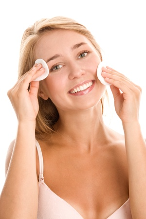 Antibacterial: Woman removing makeup with cosmetics pad