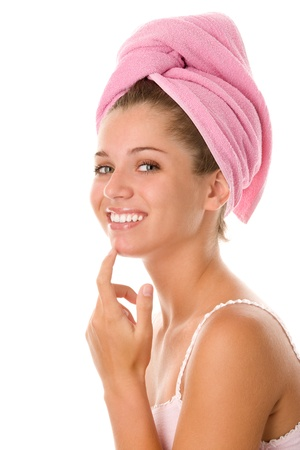 semi nude: Young woman applying face cream