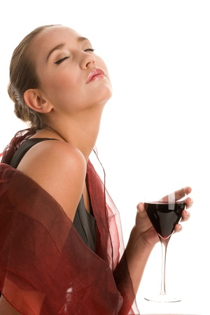 Elegant woman drinking glass of red wine photo