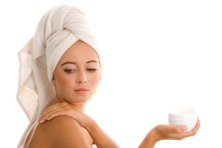 Woman applying body lotion photo