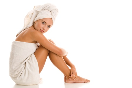 Woman relaxing at spa after bath