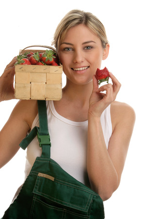 Young woman with box of strawberries photo