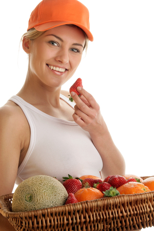Woman with basket of fruits photo