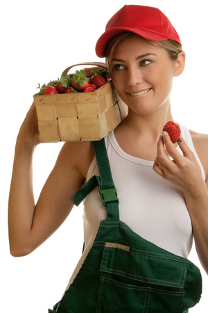 Young woman with basket of strawberries photo