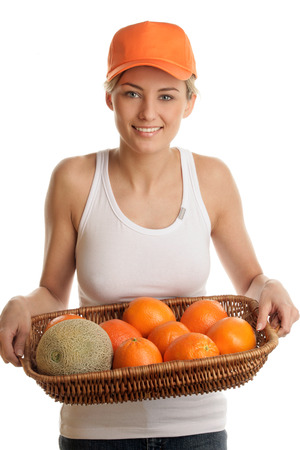 Woman with fruits in basket photo