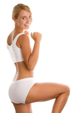 Woman in sportswear exercising photo
