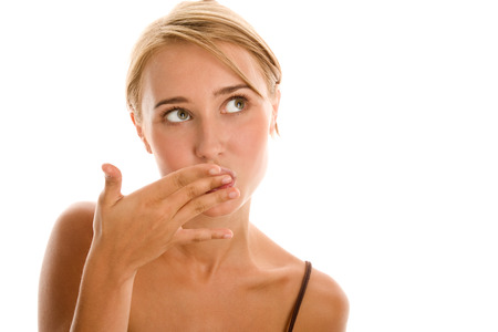 finger licking: Young woman licking her fingers