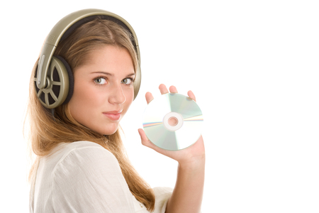 cd player: Woman listening to music holding CD