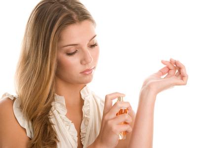 Woman spraying perfume on her wrist