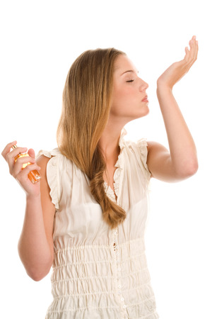 Young woman smelling perfume Stock Photo