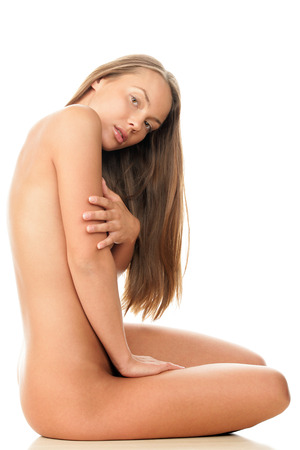 Young naked woman sitting on the floor photo