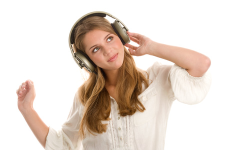 Teenage girl listening to music with headphones photo