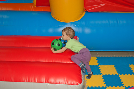 baby on a childrens trampoline