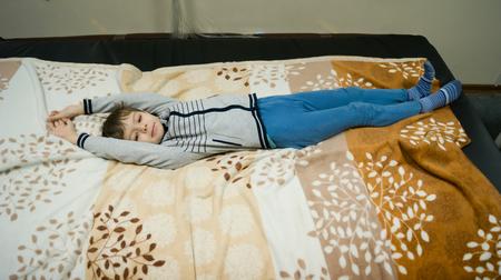 boy swinging on a water mattress Фото со стока - 116235731