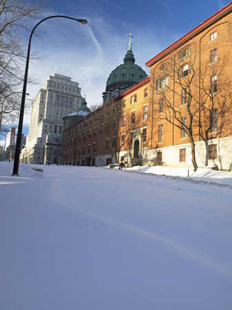 Sunny day in Montreal. Urban street covered by snow. photo