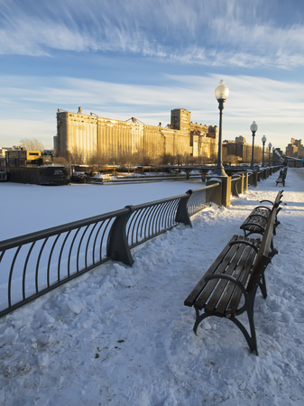 laurent: Snow sidewalk in old Montreal. Frozen Saint Laurent river