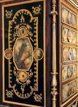furniture detail: Versailles, France - 10 August 2014 : Detail from wood furniture at Versailles Palace
