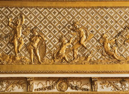 versailles: Versailles, France - 10 August 2014 : Gold ornament at Versailles Palace ( Chateau de Versailles ).