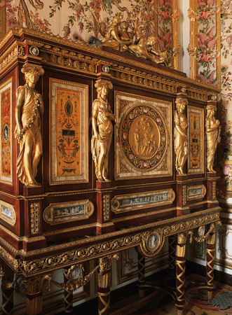 Versailles, France - 13 August 2014 : Wooden Furniture in Queen Marie Antoinette bedroom at Versailles Palace ( Chateau de Versailles ).