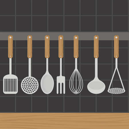 weighs: Kitchen utensils weighs on a wall in the kitchen.