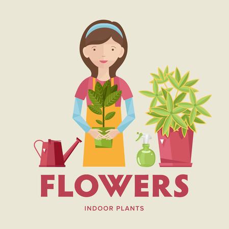indoor garden: Girl seller houseplants with a flower in her hand. Stock Photo
